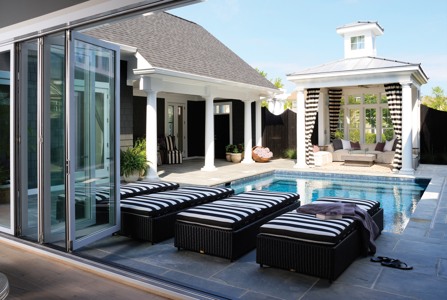 The Pool Is Flanked By A Gazebo While The Front Door Is Sheltered Under A