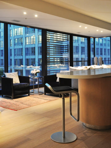 Ballou created a seating area in a CityCenterDC condo with A. Rudin chairs and a cowhide rug from Timothy Paul.