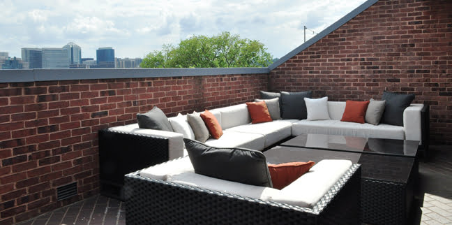 Ballou furnished a duplex terrace with a sectional from Harbour Outdoor for easy entertaining.