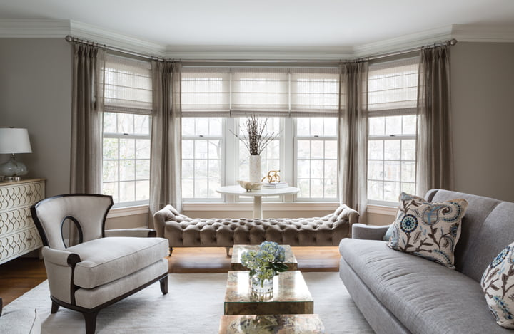 A serene living room combines a sofa and chair by Barbara Barry with a bench by Lee Industries.