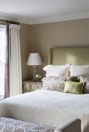 Holder enveloped the master bedroom in a sophisticated green and purple palette.