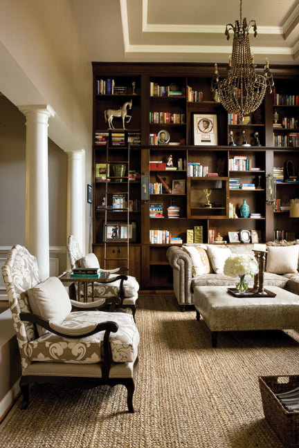 In the library, natural elements, including a jute rug by Stark, mingle with elegant touches.