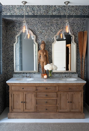 A Restoration Hardware vanity is topped with marble.