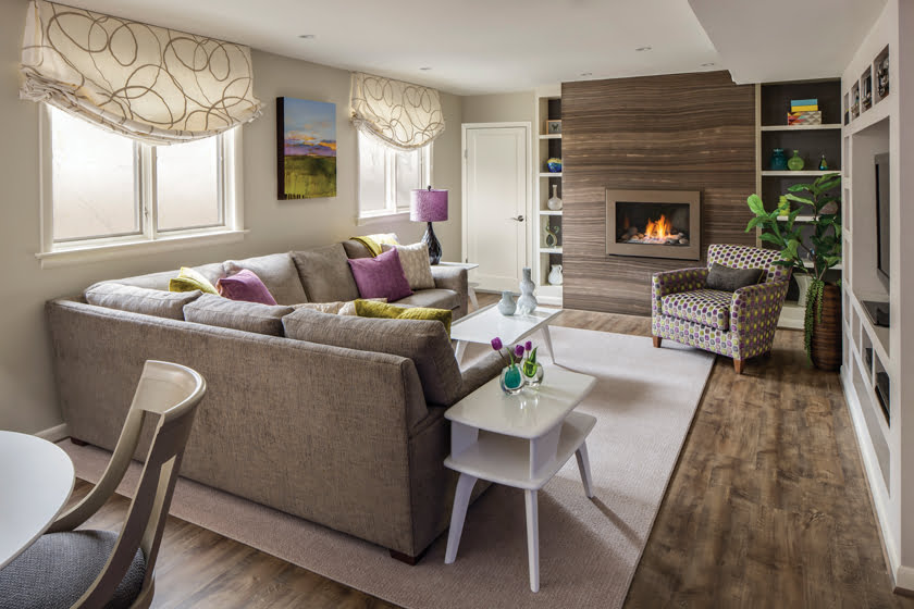 This lower-level space got a major makeover that included a dramatic, crosscut eramosa marble fireplace surround, built-in media center, and snazzy, new upholstery for existing furniture.