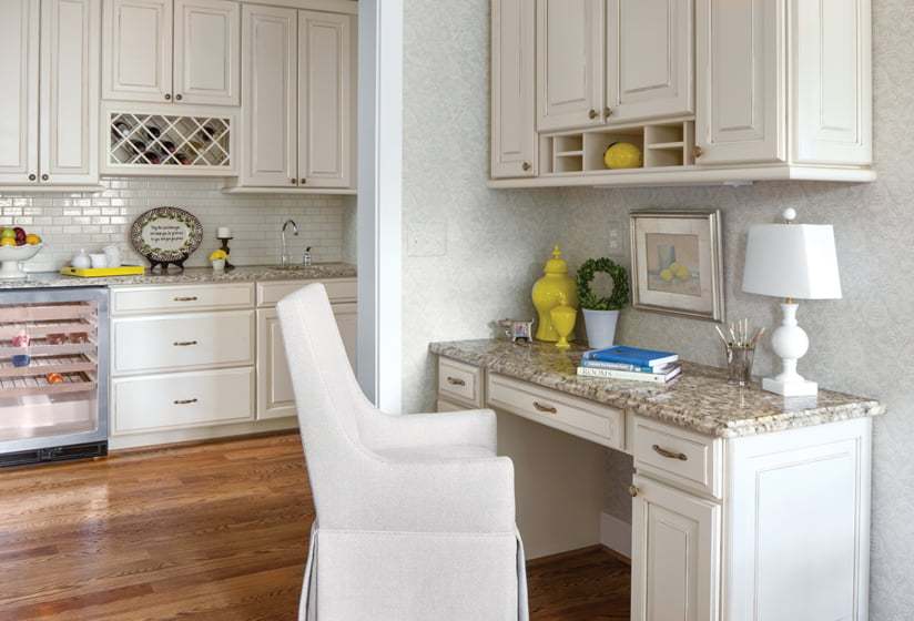 Broffman used lemon yellow accents to add zest to a butler's pantry. Wallpaper by Colefax & Fowler adds dimension and carries the room.