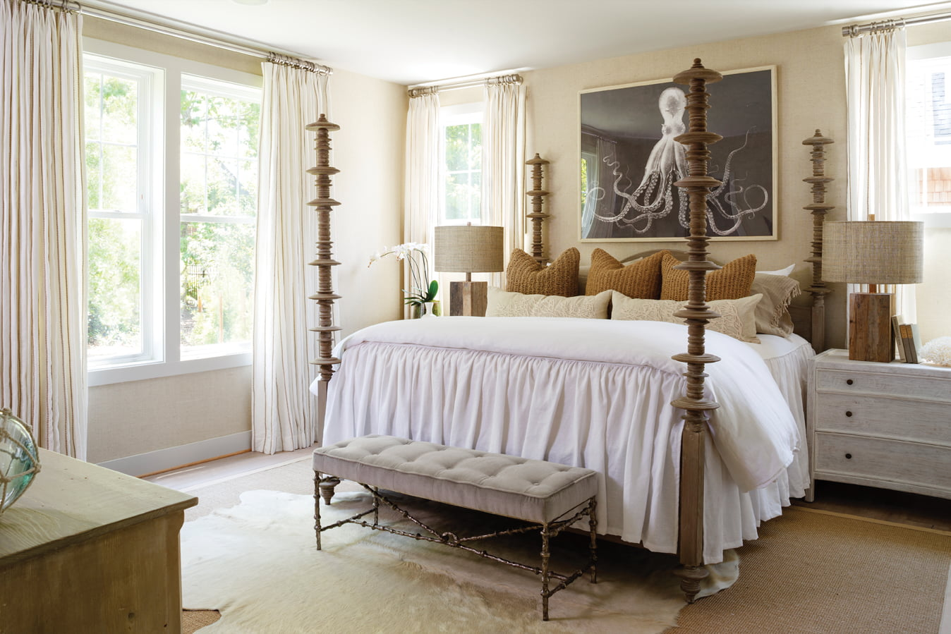 The master bedroom is papered in grasscloth from Ralph Lauren, with a bedstead from Noir Furniture and art from Natural Curiosities.