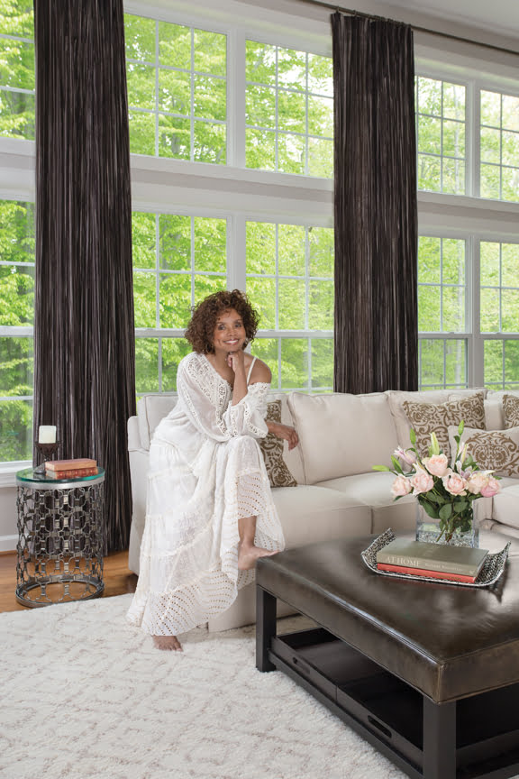 Debbi Morgan relaxes in her family room. © Jesse Snyder