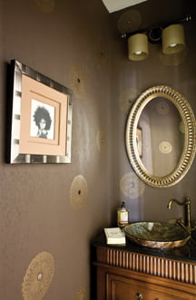 Mother-of-pearl medallions adorn the powder room's wall covering.