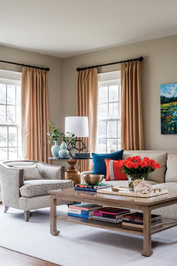 Barrel-back chairs in a cheetah print and a nubby-textured sofa in the living room keep neutrals interesting.
