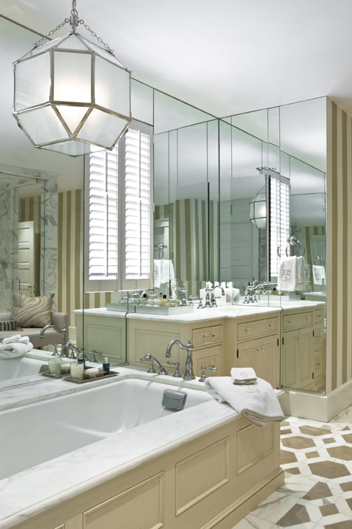 Medicine cabinets are recessed into the mirrored surfaces.
