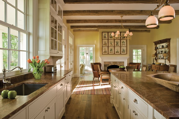 Strong country-style elements warm up the kitchen designed by Jennifer Gilmer Kitchen & Bath.