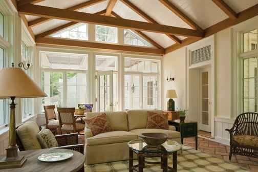 The architect designed and stained a framework of red cedar beams in the sunroom.