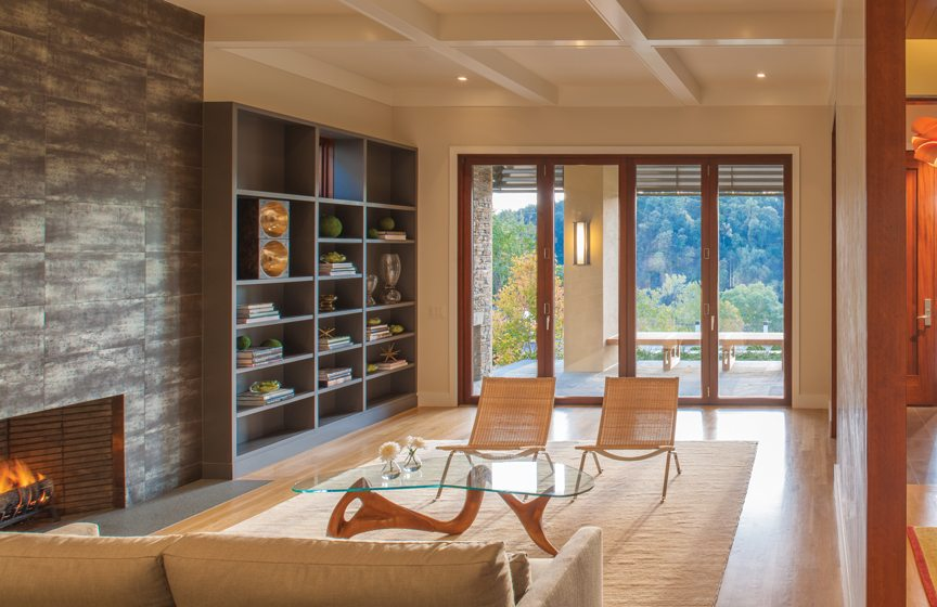 A NanaWall in the living room opens  to a front porch that overlooks the river and also boasts a fireplace.