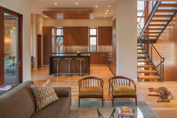 The open staircase bathes the interior in natural light.