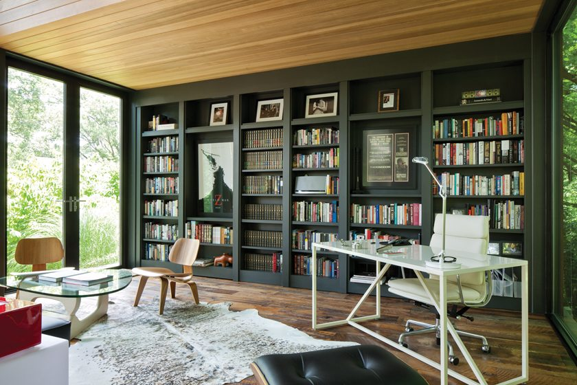 The interior boasts reclaimed whiskey-barrel oak floors and a wall of shelves lined with books.
