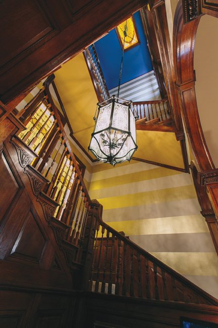The three-story staircase features original millwork.