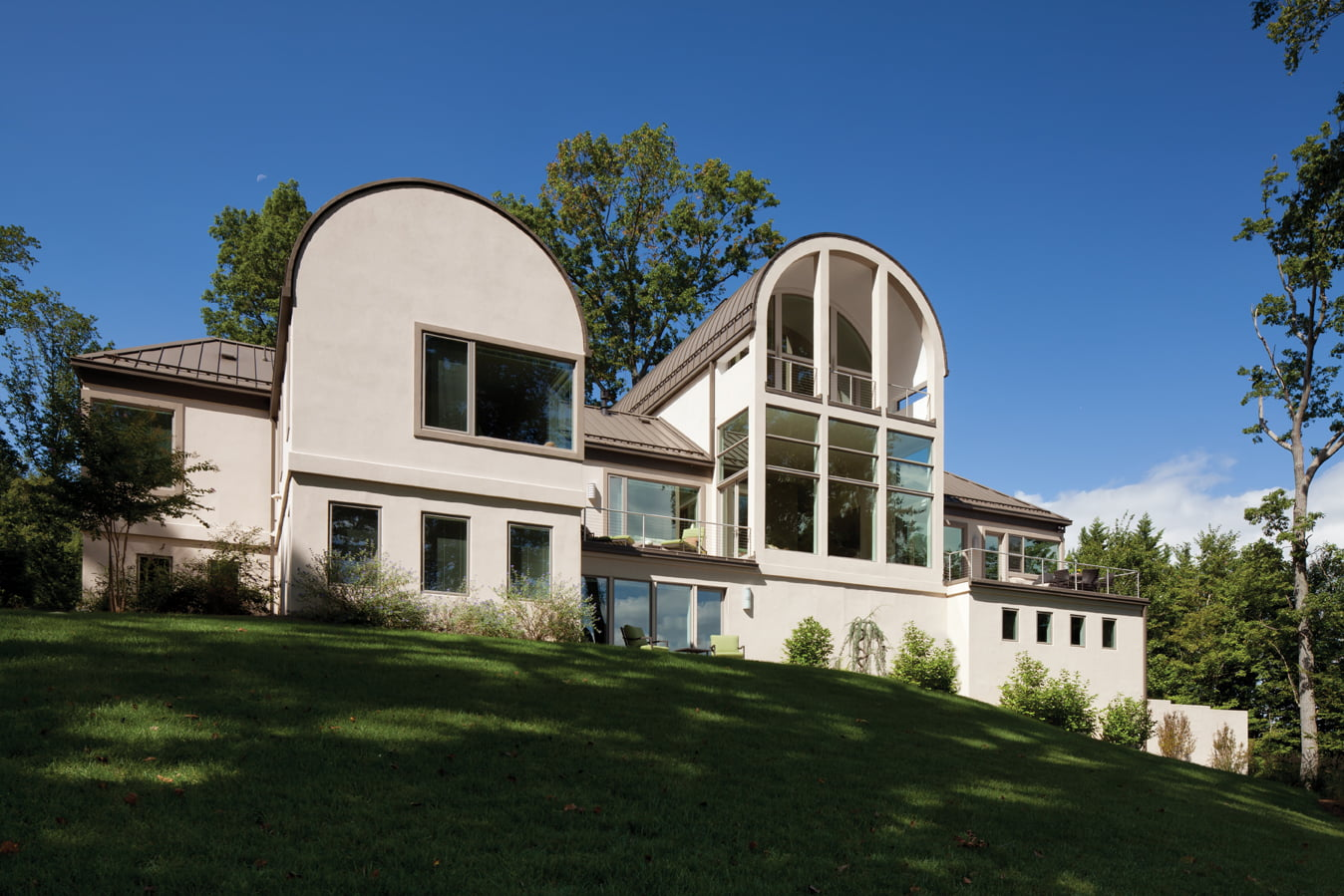 As seen from the back, the house offers views of the river through windows in nearly every room.
