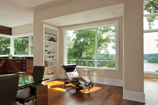 A niche by the dining area offers a lounging spot for reading or taking in the views.