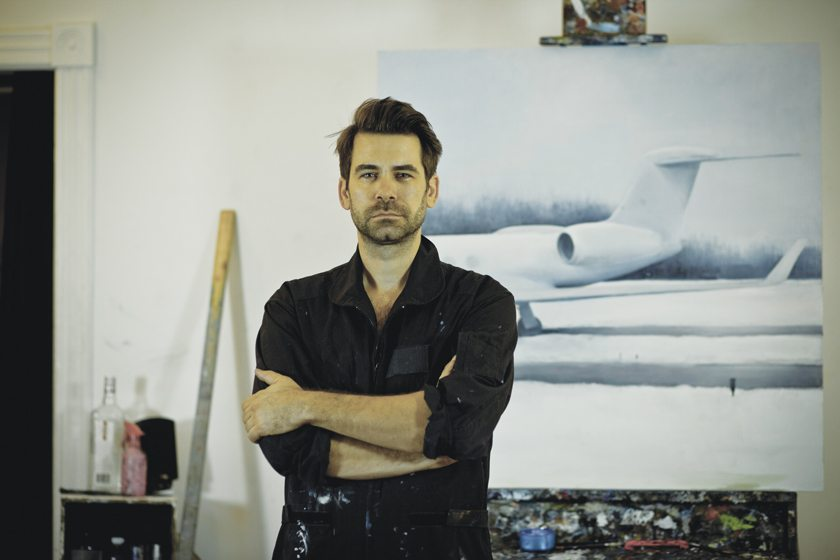 The artist, pictured in his Silver Spring studio, conveys a dynamic intensity that mirrors his work.