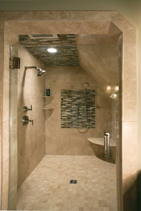 The spa-like shower is clad in tile from Mosaic Tile.