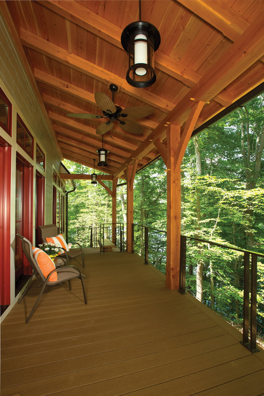 From their side porch, the Kohlers can descend through the woods to their dock, where kayaks await.