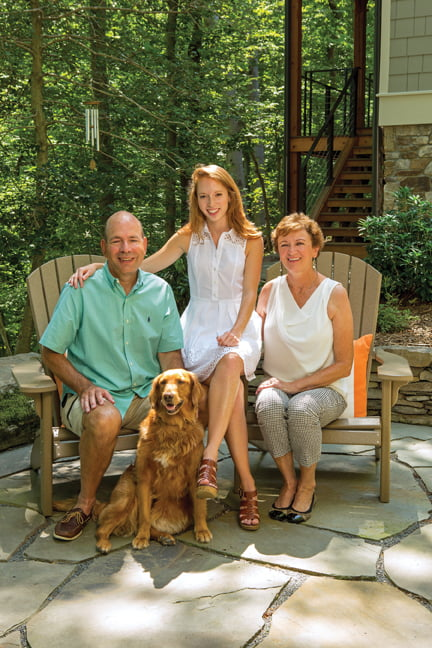 Mark and June Kohler, daughter Monica and their dog Bella relax on the patio.