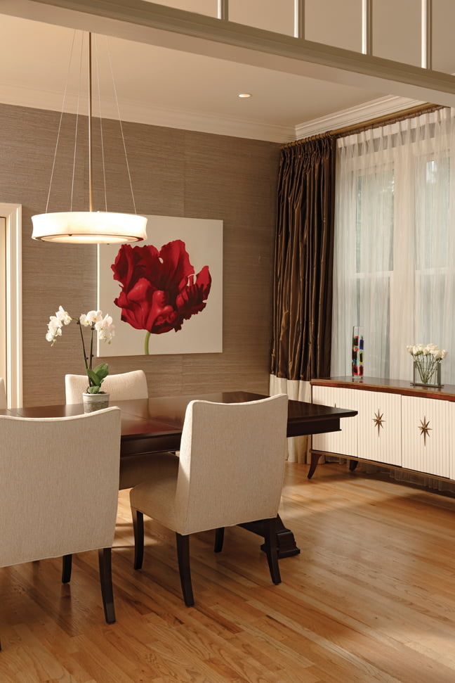 The dining room features Osborne & Little wallcovering and furniture from Urban Essentials.