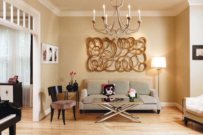 A Jackie Onassis pillow from Jonathan Adler imparts a touch of whimsy in the living room.