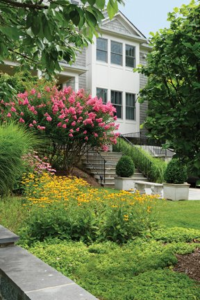 Lush landscaping welcomes guests to the front entry.