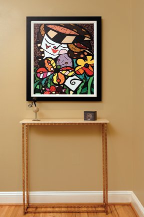 A painting by Romero Britto adds vibrant color.