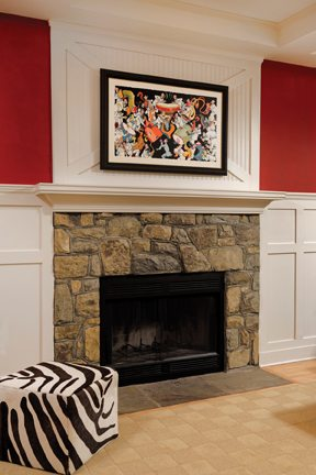 Above the stone fireplace is a numbered print by Theodor Geisel (a.k.a. Dr. Suess).