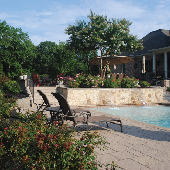 The finished landscape design features a lower pool terrace.