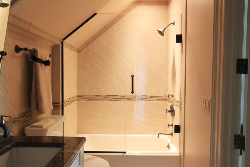 The shower enclosures are frameless, heavy glass systems that convey a high-end look.
