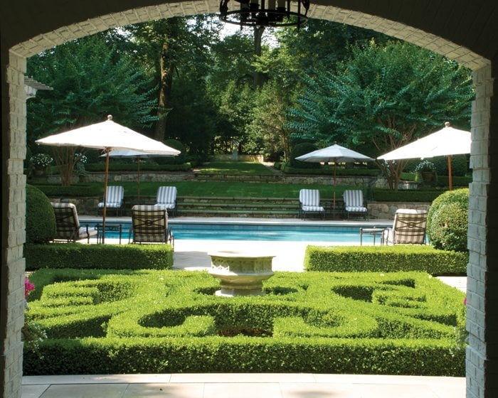 A lush, stately poolscape was designed by Charles Owen of Fine Landscapes