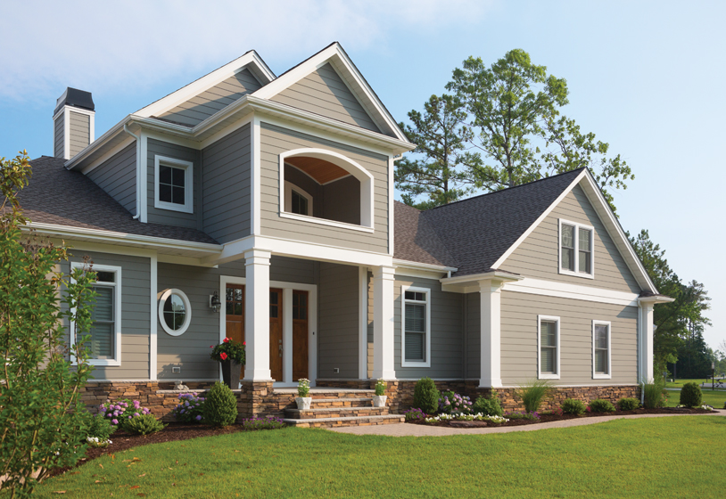 A beach-community home features Celect seven-inch traditional siding in Latte with complementary white trim.