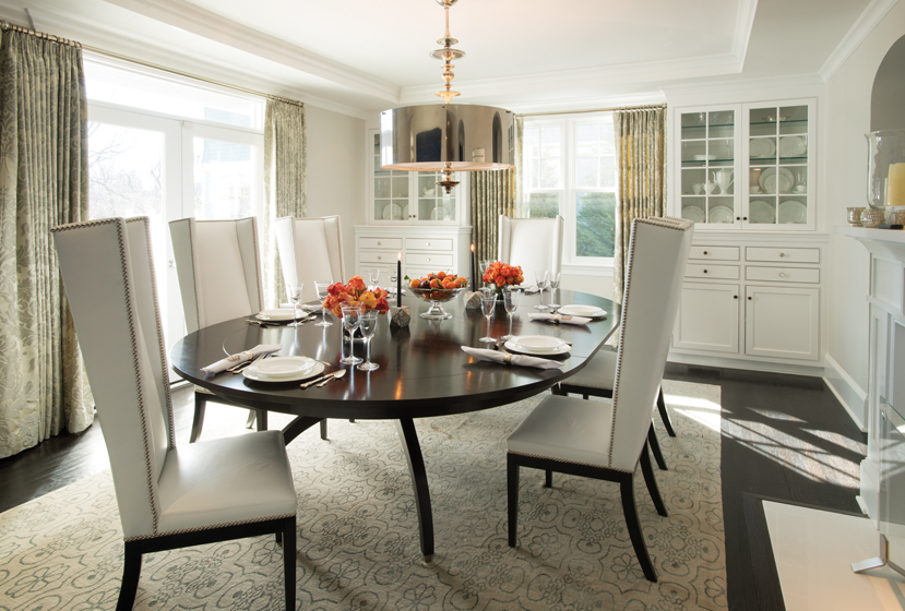 The dining room reflects Johnson's fresh approach with dramatic Artistic Frame chairs.