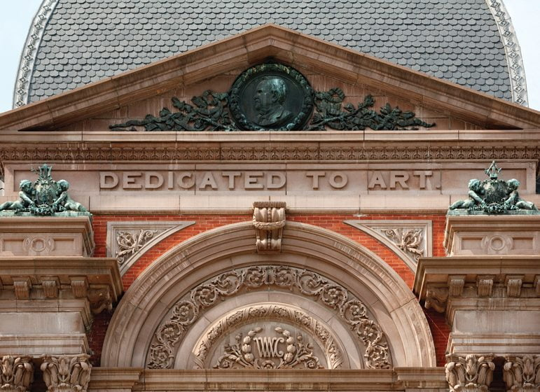 The renovation included repairs to architectural details above the front entrance. © Ron Blunt