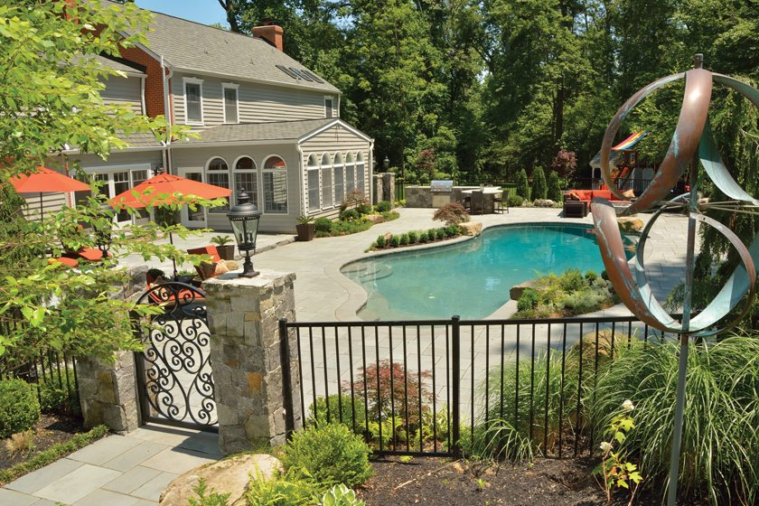 Scapes, Inc., combined a pool area, outdoor kitchen and firepit. ©  John DiCamillo