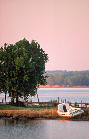 A picturesque early morning view of a boat on the Patuxent River.  © David Harp