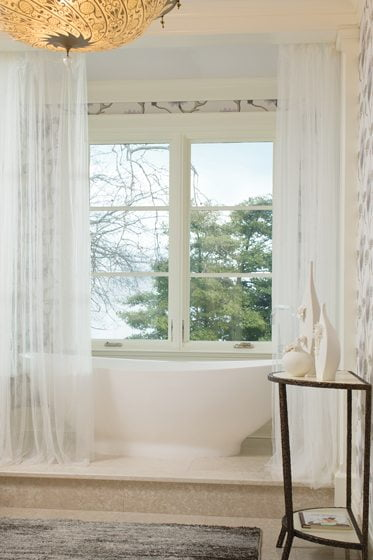 The freestanding soaking tub in the master bath offers room to relax.