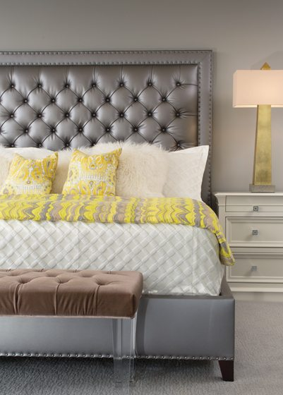 The master bedroom boasts a tufted-leather headboard from Vanguard.