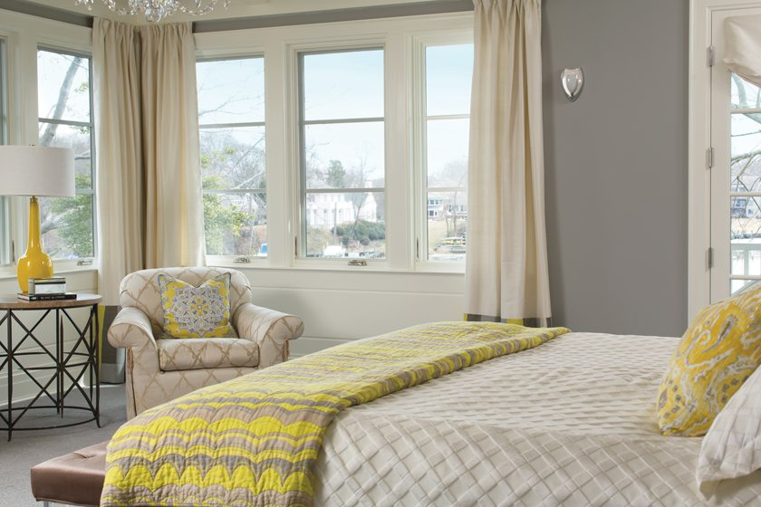 A bay in the master bedroom holds a cozy  armchair.