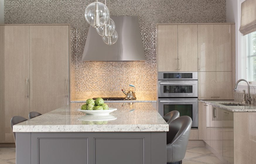 In the kitchen, sleek, modern Downsview cabinetry stands out against a metallic glass-tile backsplash.