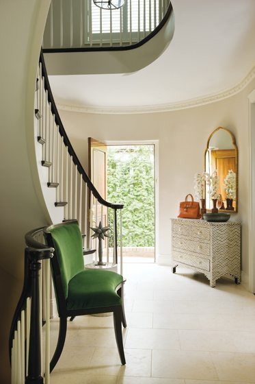 The foyer's curved sette was custom-made to fit the space.