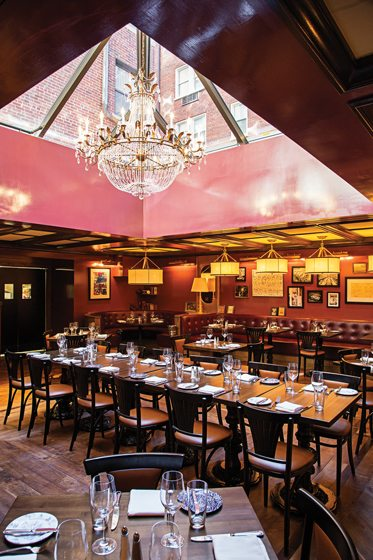 Leather booths and brass accents highlight The Riggsby dining room. © Scott Suchman