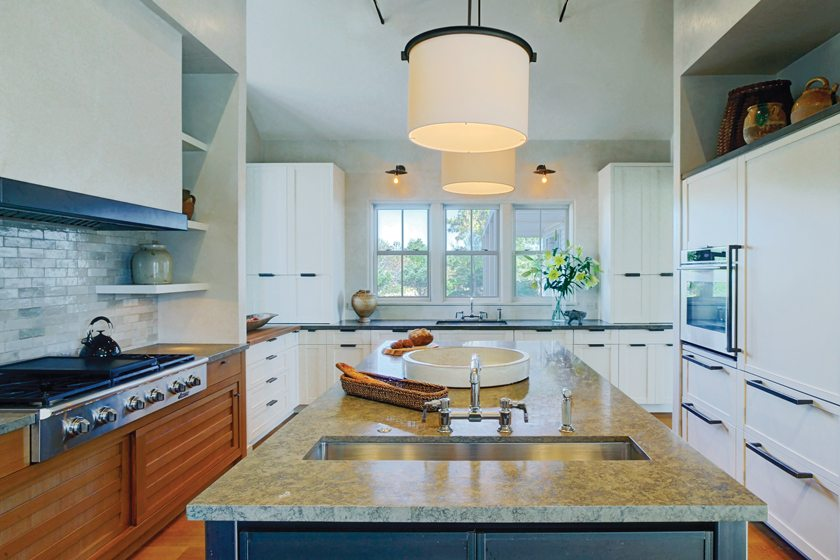 The functional layout places cabinetry and appliances in a U shape surrounding a large island.