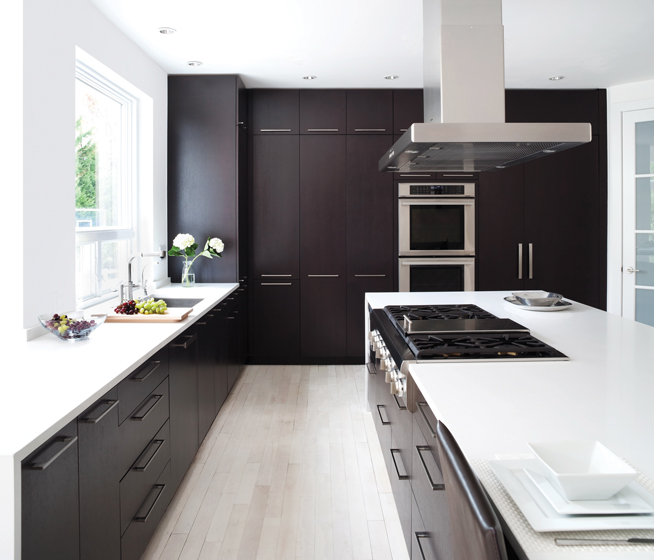 The kitchen offsets dark espresso cabinetry with white Caesarstone countertops.