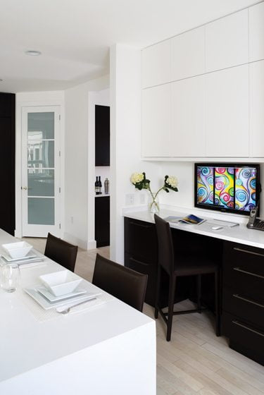 The desk area incorporates matching cabinetry.