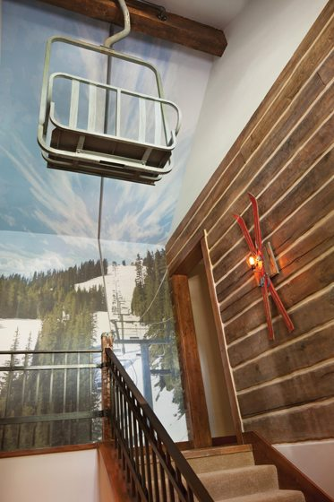 A mural of an Aspen slope by Swatchroom provides the backdrop to an actual ski-lift chair.