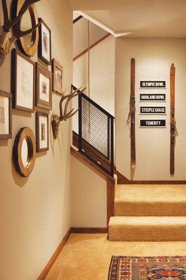 Signs from the family's favorite Aspen ski run decorate the stairs.